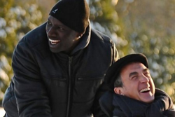 Philippe y Driss ríen a caracajas